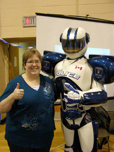 Kimberly Miller with Robo Cop at Discoveryfest